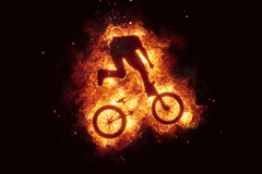 Burning bike bmx biker bikinig fire flames. Sport Stock Photos