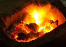 Burning billets in hot stove. Close up Stock Photos