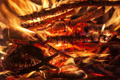 Burning billets in hot stove Royalty Free Stock Photos