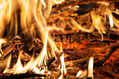 Burning billets in hot stove Stock Photography