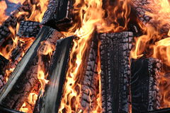Burning billets. Burning logs burned in the fire - background Stock Photos