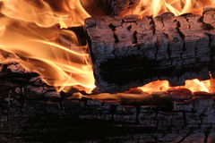 Burning billets. Burning logs burned in the fire - background Royalty Free Stock Photos