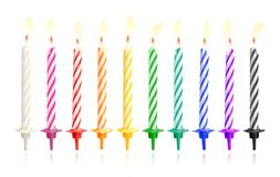 Burning birthday candles isolated on dark background with fire flames. Colorful collection. Clipping path stock images