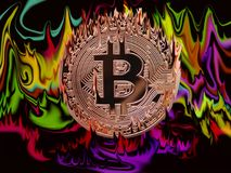 Burning Bitcoin. Bitcoin on fire on a color full fiery background Stock Images