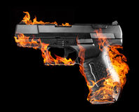 Burning black pistol Royalty Free Stock Photos