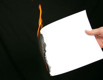 Burning blank paper for message. Time running out burning edge of paper Royalty Free Stock Images