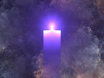Burning blue candle. A  burning blue candle set against a mottled cloud background Stock Photos