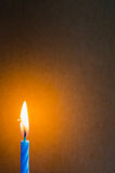 Burning blue candle  on the table Royalty Free Stock Photography