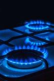 Burning blue gas Stock Images
