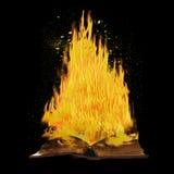 Burning book on black background. Stock Image