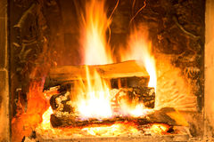 Burning bright fireplace with firewood Stock Photography