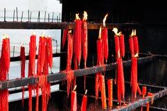 Burning Buddhist Prayer Candles Stock Photography