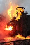 Burning building. A completely stagnant in flames building that is destroyed Stock Photo