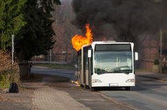 Burning bus Stock Images