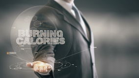 Burning Calories Businessman Holding in Hand New technologies Royalty Free Stock Photos