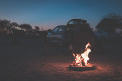 Burning camp fire at dusk in camping site, Botswana, Africa. Summer adventures and exploration in the african National Parks. Sele Royalty Free Stock Image