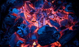 Burning campfire embers (hot coal). Embers burning inside a brazier Stock Images