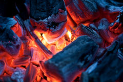 Burning campfire embers (hot coal). Embers burning inside a brazier Stock Photo