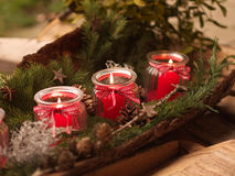 Burning candels. Three burning red candels - christmas deco Royalty Free Stock Images