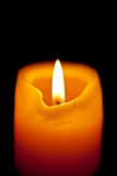 Burning candle. Closeup of burning candle isolated on black background Stock Images