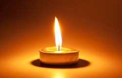 Burning candle. In the dark Royalty Free Stock Photos