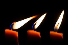 A burning candle. Stock Photos