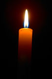 Burning candle. Romantic burning candle on black background Royalty Free Stock Photography