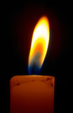 Burning candle. Romantic burning candle on black background Stock Photos