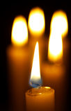 Burning candle. Romantic burning candle on black background Royalty Free Stock Image