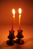 Burning candle. With antique metal candlestick Royalty Free Stock Image