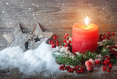 Burning candle. In the snow Royalty Free Stock Photography