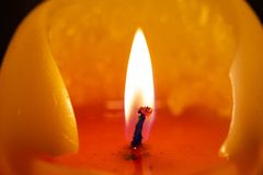 Burning candle. Closeup shot of a warmly burning candle Stock Images