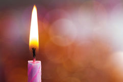 Burning candle. On an abstract background Royalty Free Stock Photography