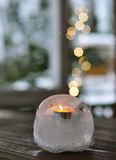 Burning candle. On a blurr lights background Royalty Free Stock Photo
