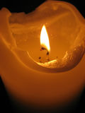 Burning candle. In dark church Royalty Free Stock Photography