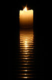 Burning candle. With reflection on the black Royalty Free Stock Photos
