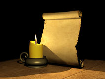 Burning candle and the ancient manuscript Stock Photo