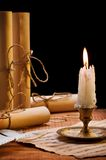 Burning candle and antique items Stock Image