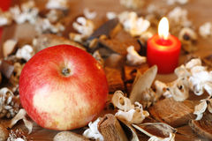 Burning Candle, Apple And Dried Plants Royalty Free Stock Photography