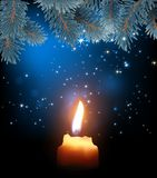Burning candle on the background of the night starry sky and fir stock illustration