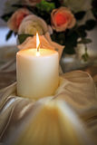 Burning Candle on Banquet Table Stock Photos