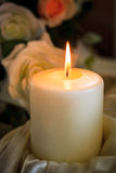Burning Candle on Banquet Table Stock Images