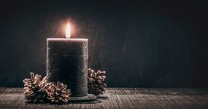 Burning candle on a black background stock images