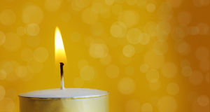Burning candle with blur background Stock Image