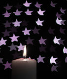 Burning candle with blur violet stars on black background. Abstract - burning candle with blur violet stars on black background Stock Photography