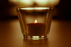 Burning candle with blurred light in the back Royalty Free Stock Photos