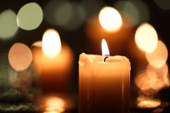 Burning candle with bokeh. Burning candle with light in the background Royalty Free Stock Photography