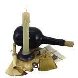 Burning candle with bottle, scroll and key. Retro composition with burning candle, bottle of rum, shabby scroll, hessian bag and key isolated Stock Images