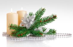 Burning candle with branch firtree and silvery bow Stock Photo