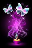 Burning candle with butterflies and stars Royalty Free Stock Photography